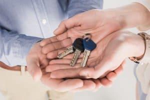 couple holding keys together