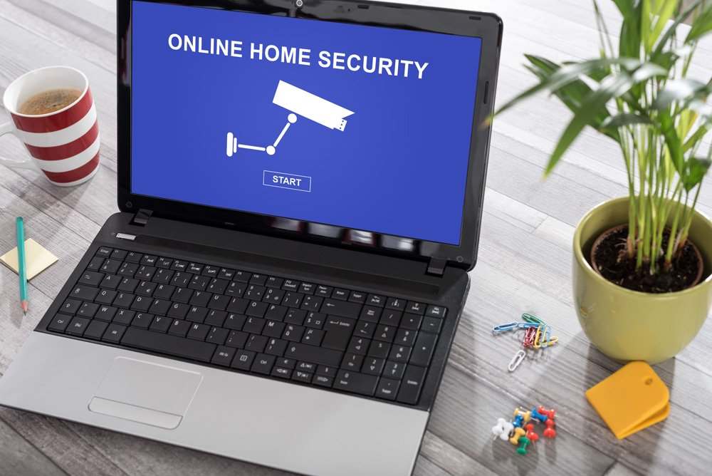 "laptop with ""Online Home Security"" page shown"